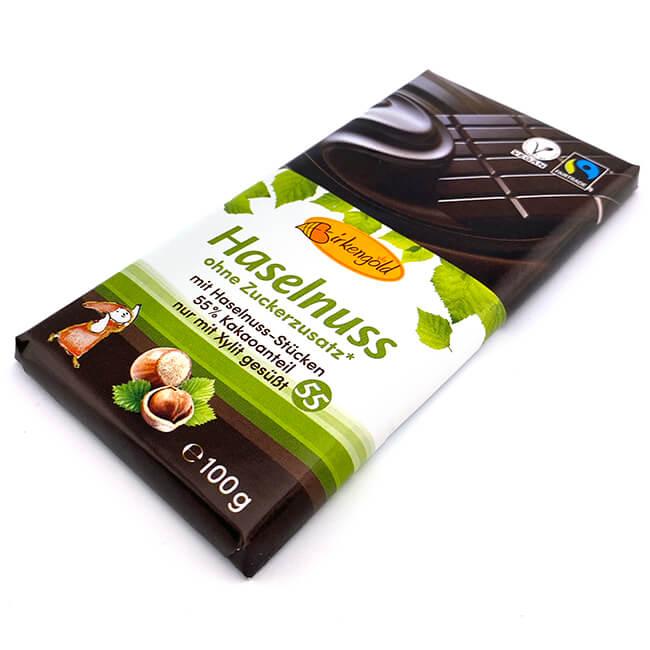 Birkengold Haselnuss Schokolade 100 g. Birkengold® Schokolade mit Haselnuss-Stückchen hat einen Kakaoanteil von 55%. Mit 11% Haselnuss Stücken.