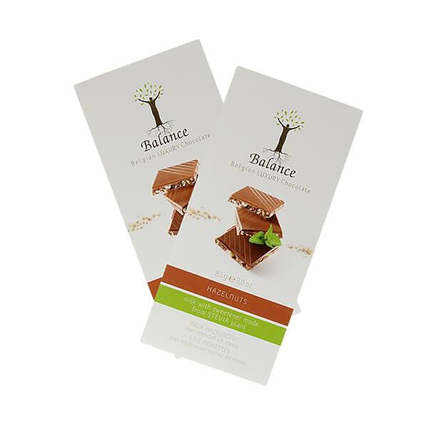 Balance Belgian Luxury Chocolate mit Stevia Milch Haselnuss 85 g. Herzhafte Milchschokolade mit Haselnüssen aus Belgien. Mit wertvollem Stevia gesüßt.